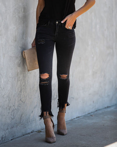 Amber Mid Rise Distressed Zip Skinnies