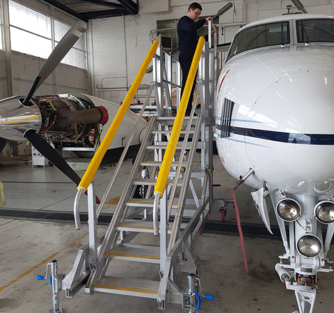 maintenance stairs on KingAir B250 with yellow handrails