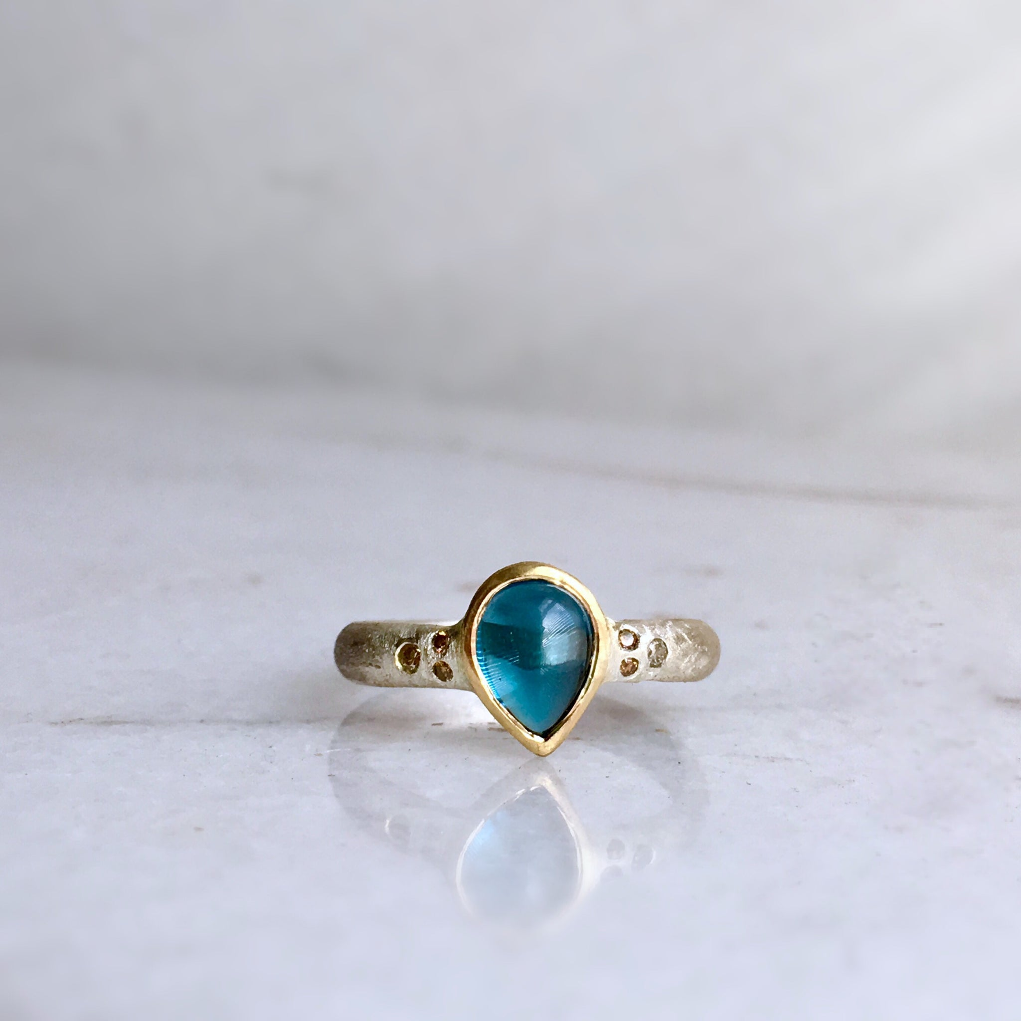 LONDON BLUE TOPAZ + DIAMOND TWO-TONE RING