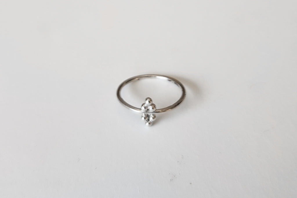 Triangle beads stacking ring