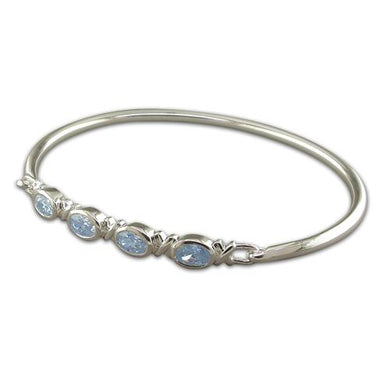 Sterling Silver Oval Blue Topaz 4 In-Line Bangle