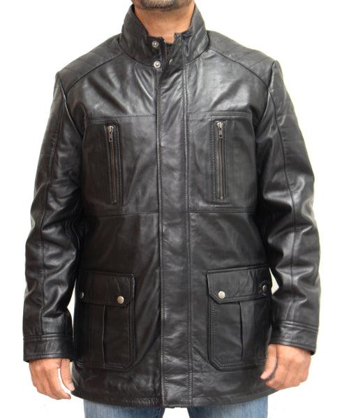 Stylish sheep leather black reefer style coat available in black and dark brown. The coat has buttoned waist patch pockets, vertical zipped breast pockets and two internal pockets.  The waist patch pocket has a T-Design. The coat has a well stitched chinese collar with extra panelled stitching for design. The front zip fastening is enhanced with an invisible panelled buttoned overly.  Ribbed design stitching on the shoulders and top sleeves.