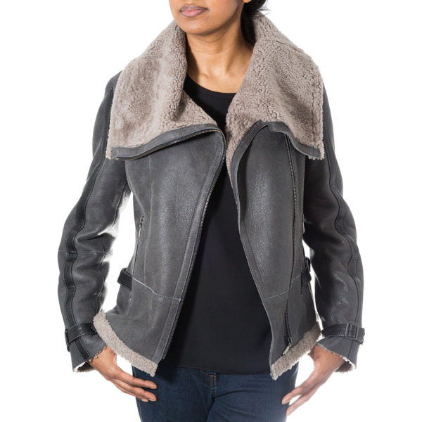 Womens shearling sheepskin side zip short biker jacket with large collar.