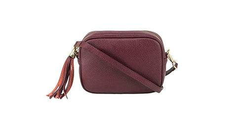 Burgundy real soft leather compact cross body bag with leather tassel attached to zipper closure