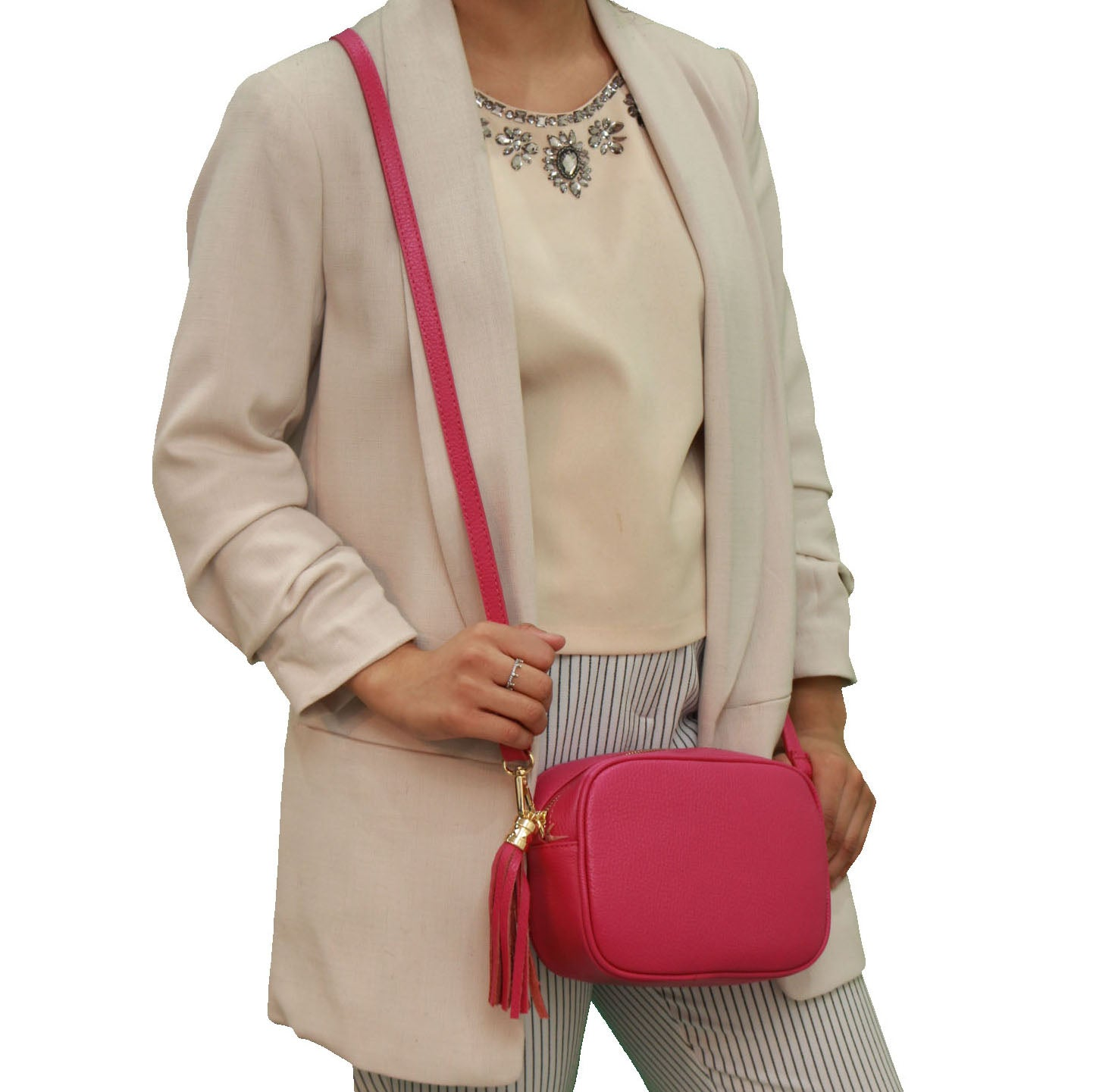 Fuchsia real soft leather compact cross body bag with leather tassel attached to zipper closure