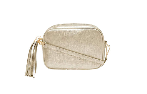 Gold real soft leather compact cross body bag with leather tassel attached to zipper closure