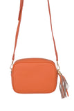 Orange real soft leather compact cross body bag with leather tassel attached to zipper closure