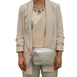 Silver real soft leather compact cross body bag with leather tassel attached to zipper closure