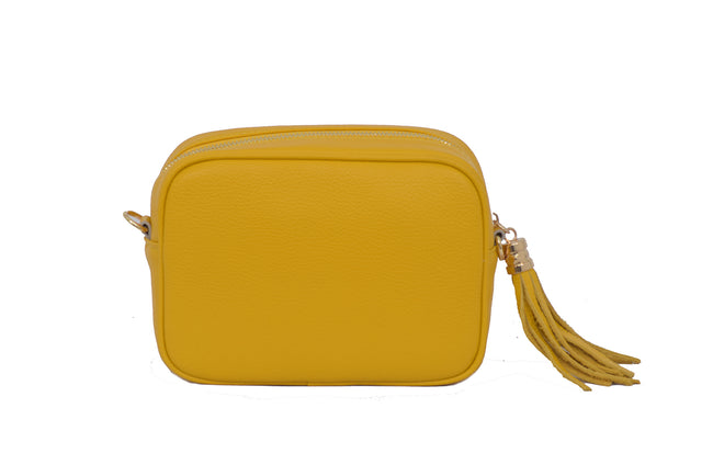 Yellow real soft leather compact cross body bag with leather tassel attached to zipper closure