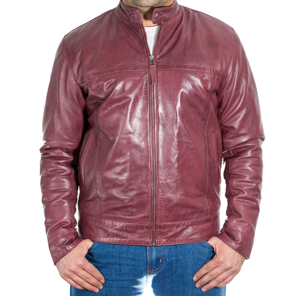 Mens leather fitted jacket with stand collar and tab fastening.