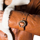Womens shearling sheepskin double breasted pea coat with belt tie. Available in Black and Tan