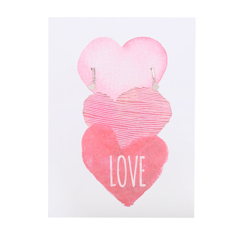 Little Heart earrings on a postcard