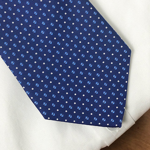 Blue Evans tie worn with white shirt