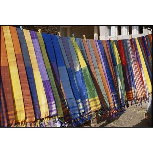 A rainbow of colored scarves await buyers at the Kom Ombo marketplace