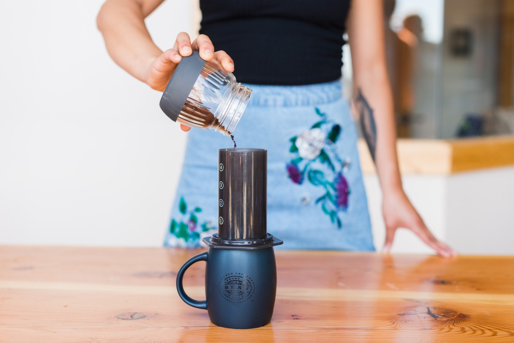 using an aeropress to make a cup of coffee