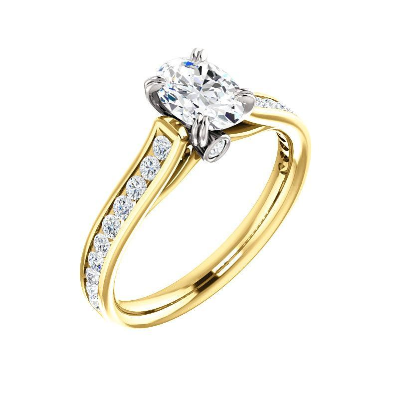 The Tracee Moissanite oval moissanite engagement ring solitaire setting yellow gold and white gold basket