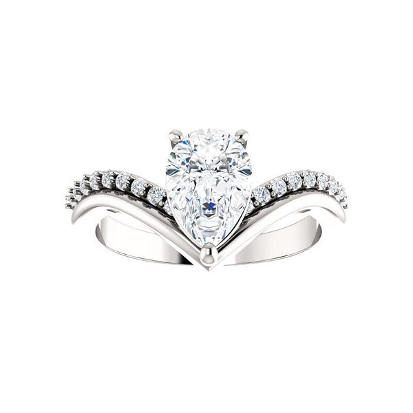 The Nelda Moissanite pear moissanite engagement ring solitaire setting white gold