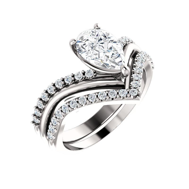 The Nelda Moissanite pear moissanite engagement ring solitaire setting white gold with matching band