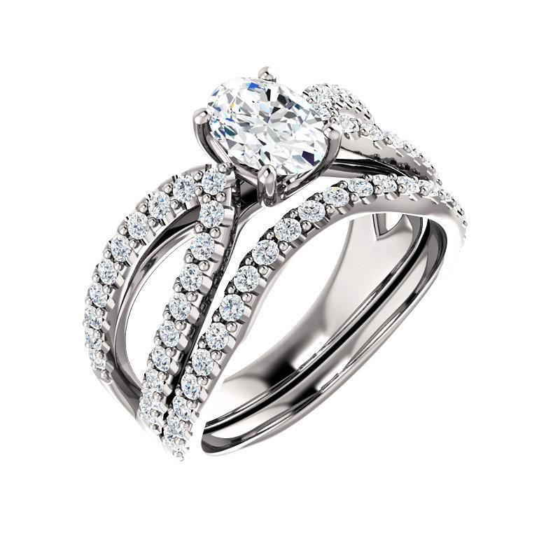 The Tia Moissanite oval moissanite engagement ring solitaire setting white gold with matching band