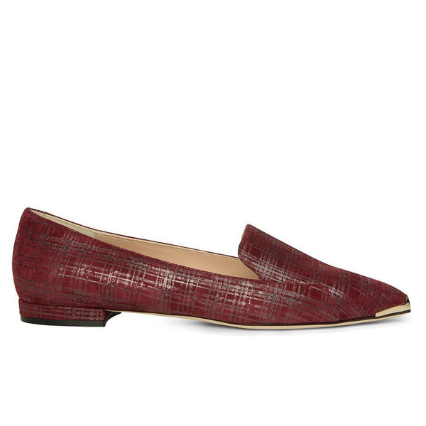 Red flats with brass pointed toe detail