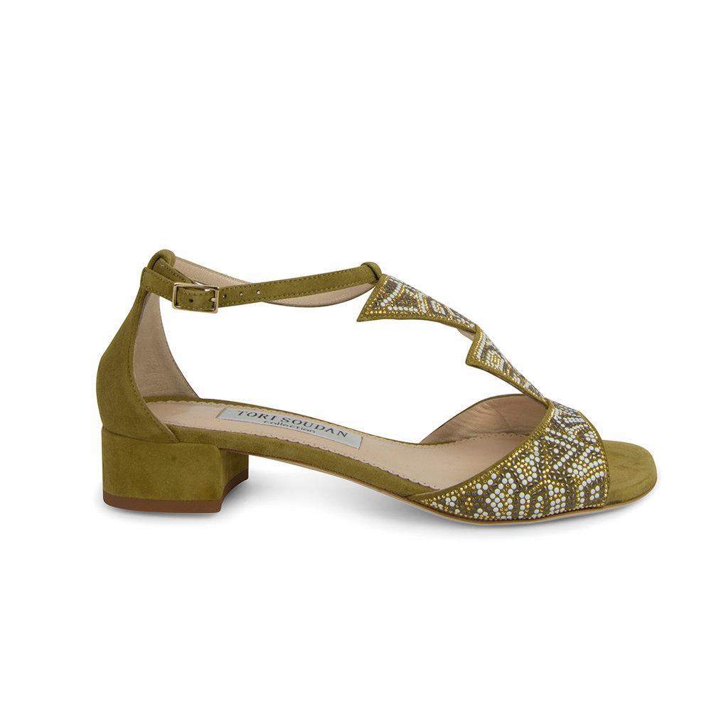 green sandals with Sworavski crystal embellishments and a slight heel