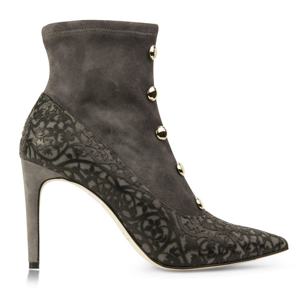 Gray suede booties with laser cut overlay design and brass bead detail
