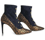 Navy blue suede booties with gold laser cut overlay design and brass bead detail