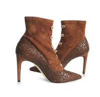 brown suede booties with laser cut overlay design and brass bead detail