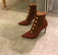 Brown suede booties with red laser cut overlay design and brass bead detail