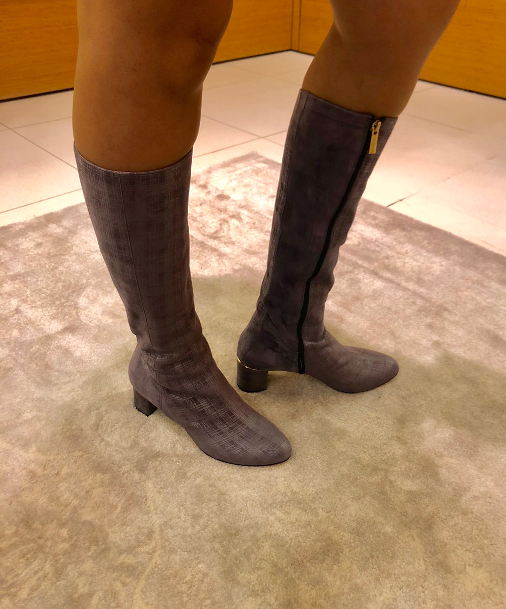 Knee-high light purple boots with a low heel