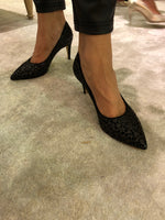 black pumps with laser design