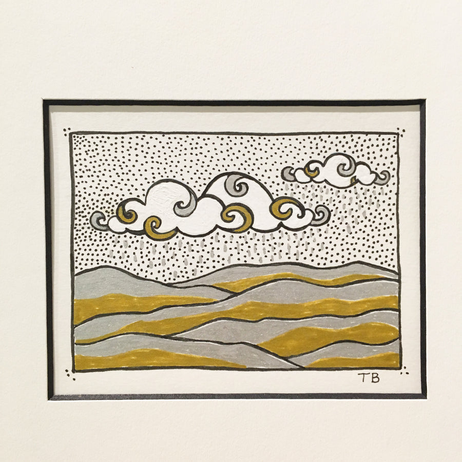 Gold, silver and black ink drawing on paper. Clouds and hills mountains. Tiny art.