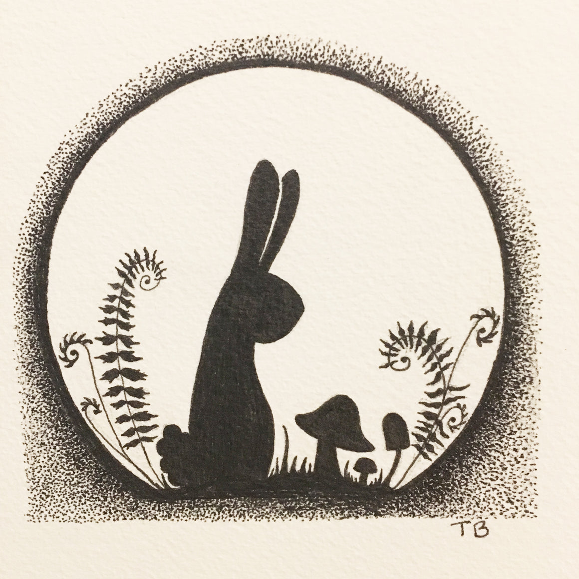 Pen and ink drawing with bunny rabbit, mushrooms and ferns.