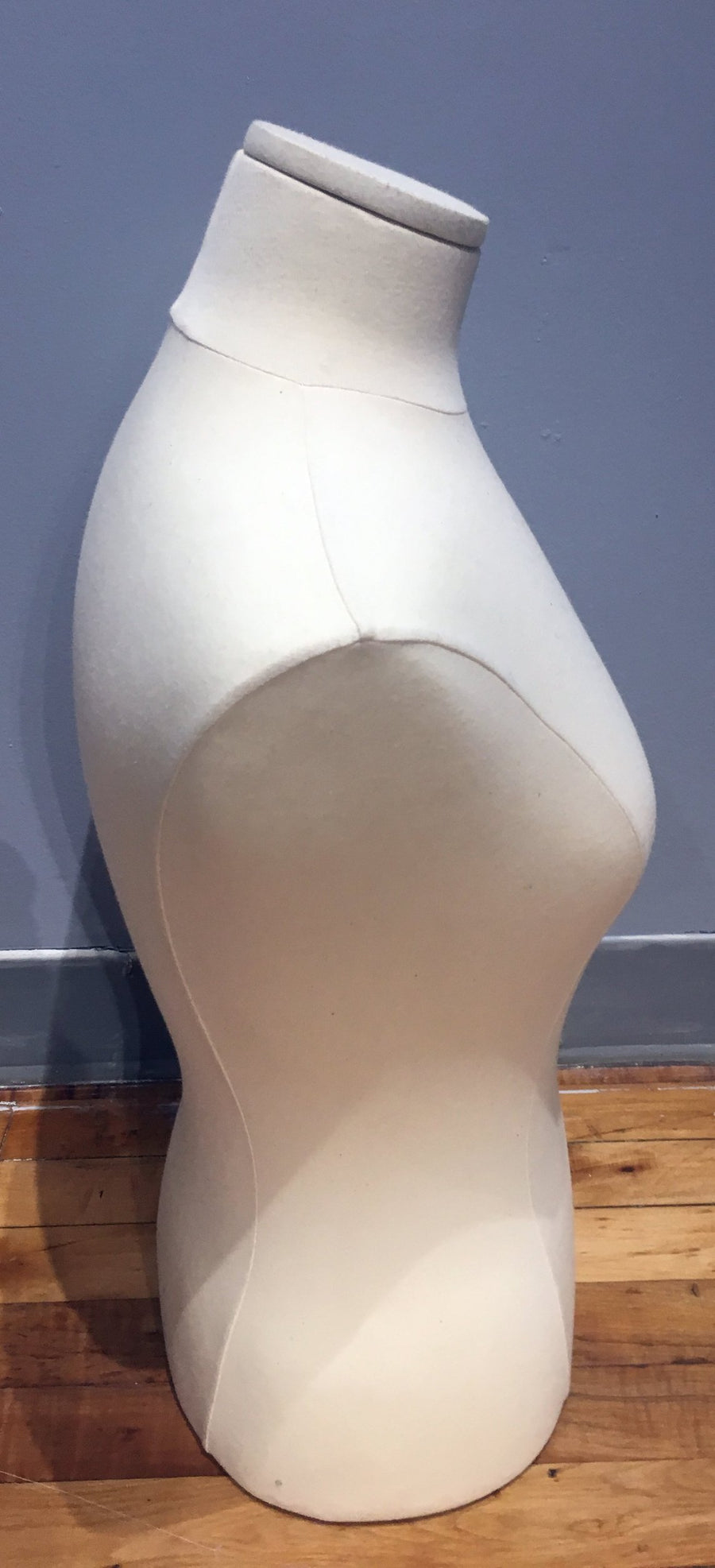 beige lycra covered headless female pinnable bust form with no arms