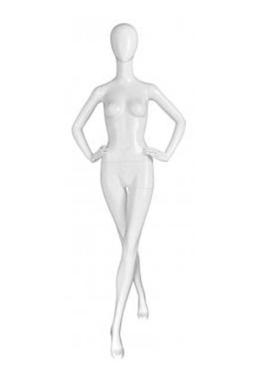 alabaster female mannequin with blank face and hands on hips