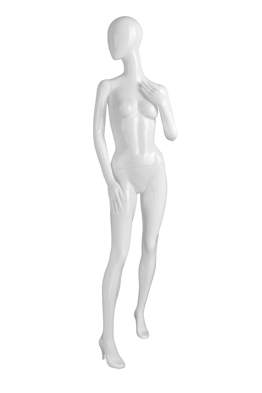 pure white female mannequin with blank face and left arm bent to touch chest and right leg stepping forward