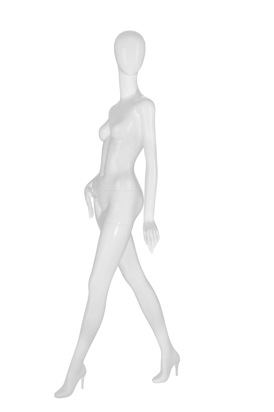 pure white female mannequin with blank face, right arm resting on hip, left leg stepping forward