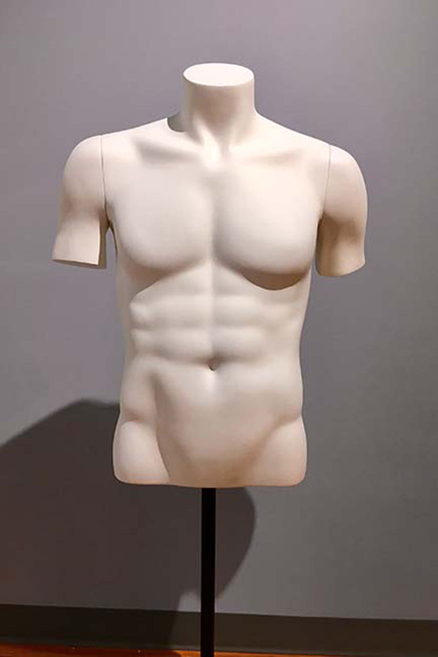 pure white headless male torso mannequin with arm nubs