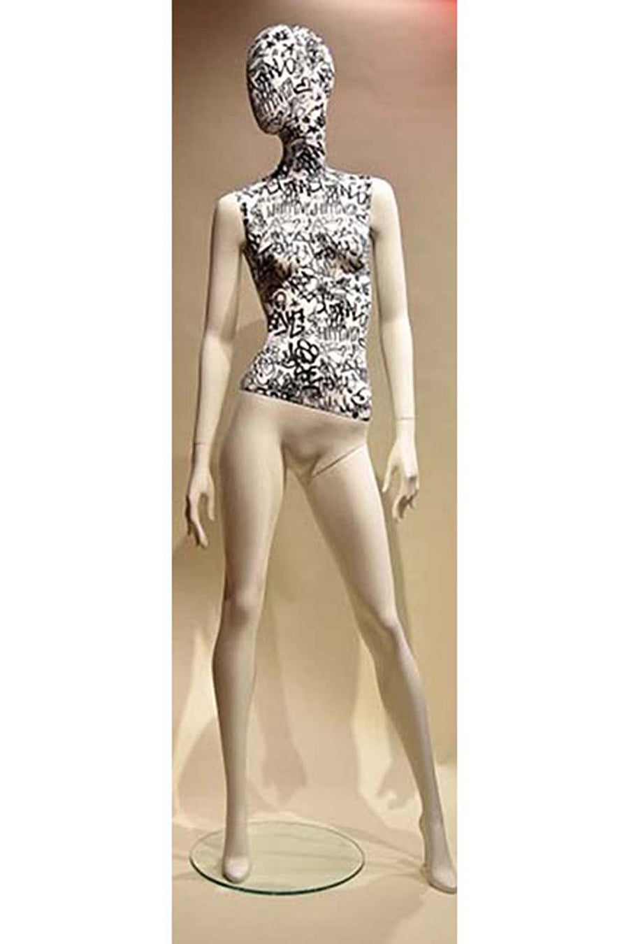 female mannequin with graffiti torso and head and pure white arms and legs