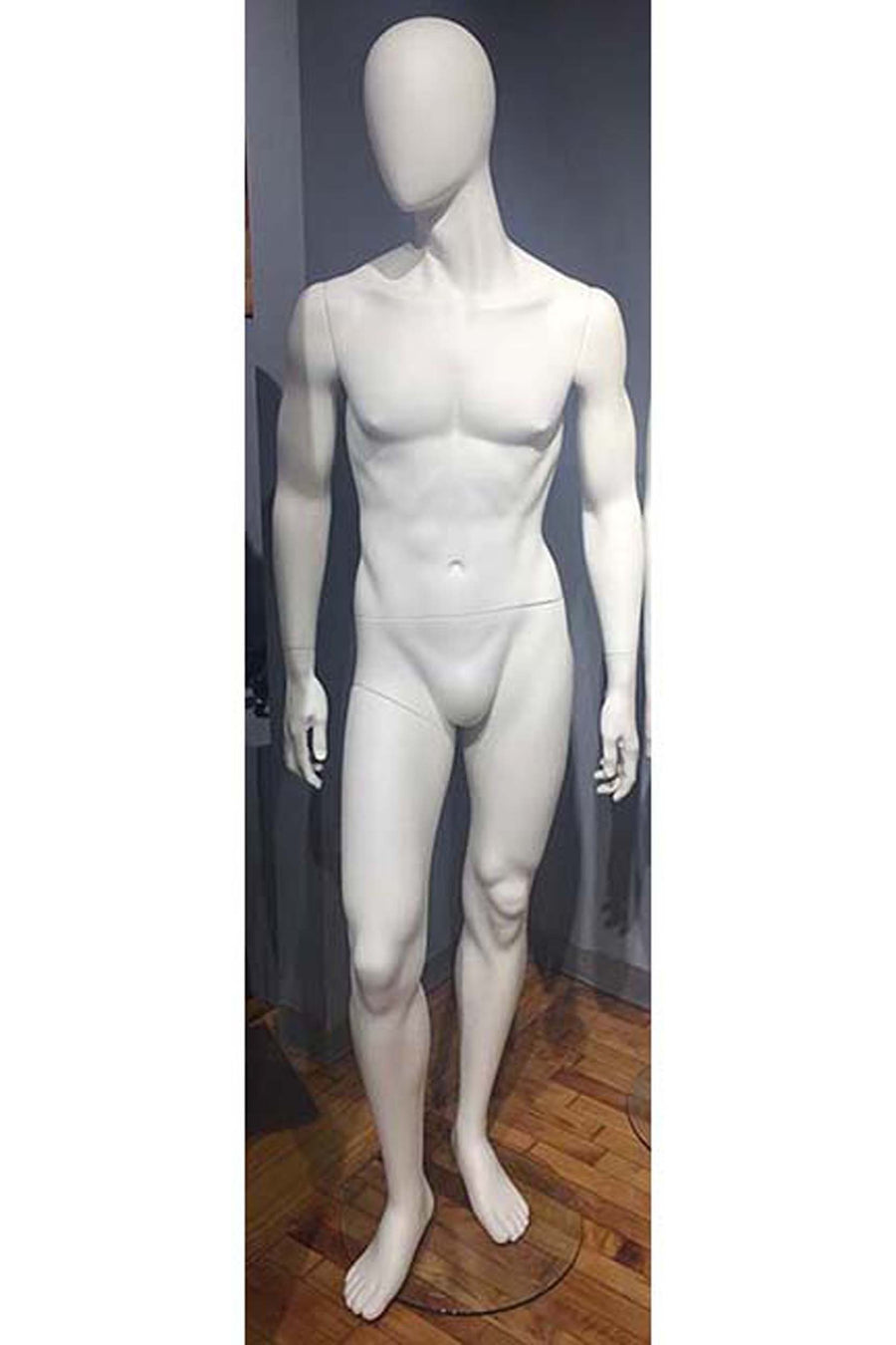 pure white male mannequin with blank face and relaxed arms and legs