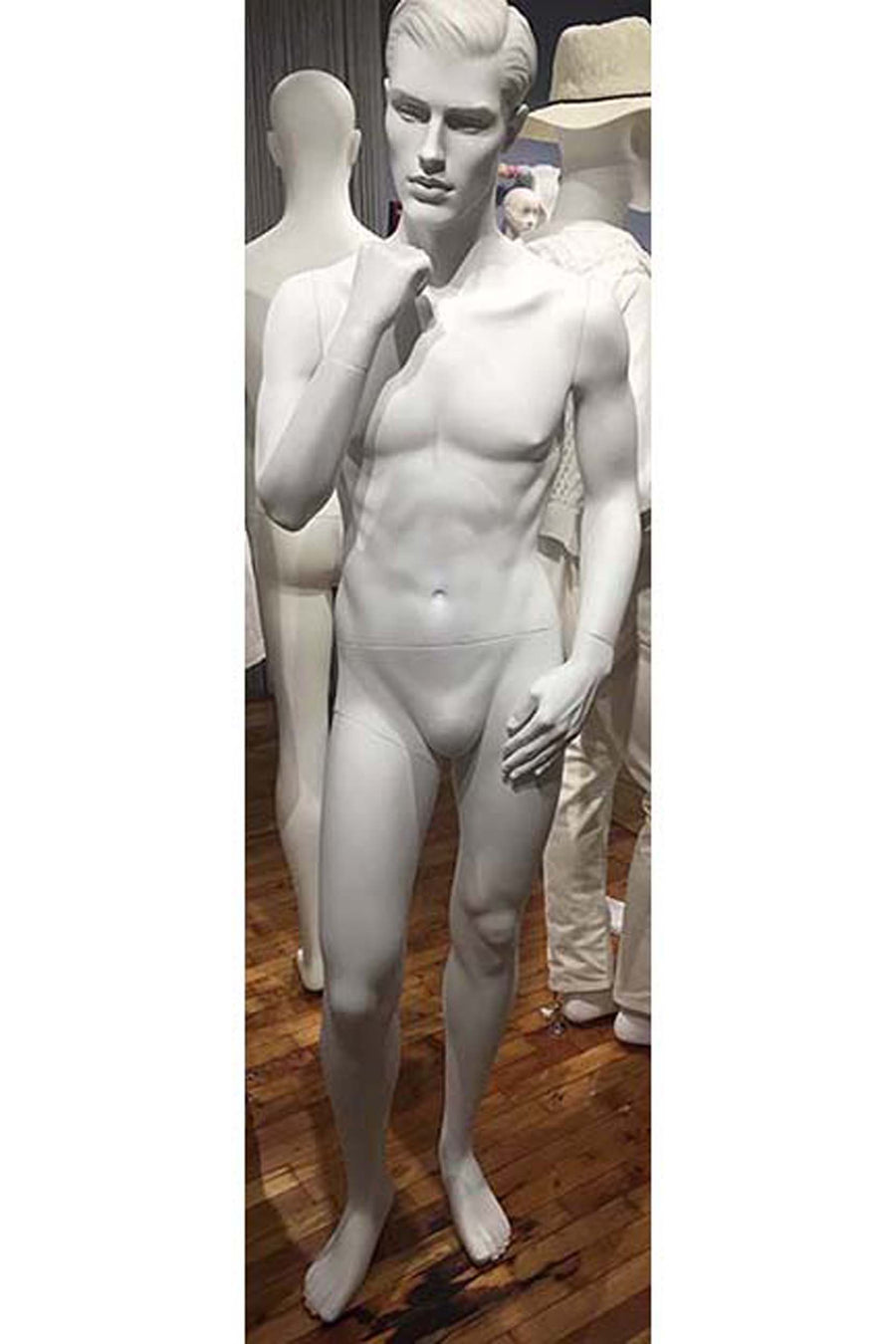 light grey male mannequin with chin resting on right hand