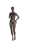 grey metallic high gloss female mannequin with blank face, left hand on hip and right hand touching right shoulder