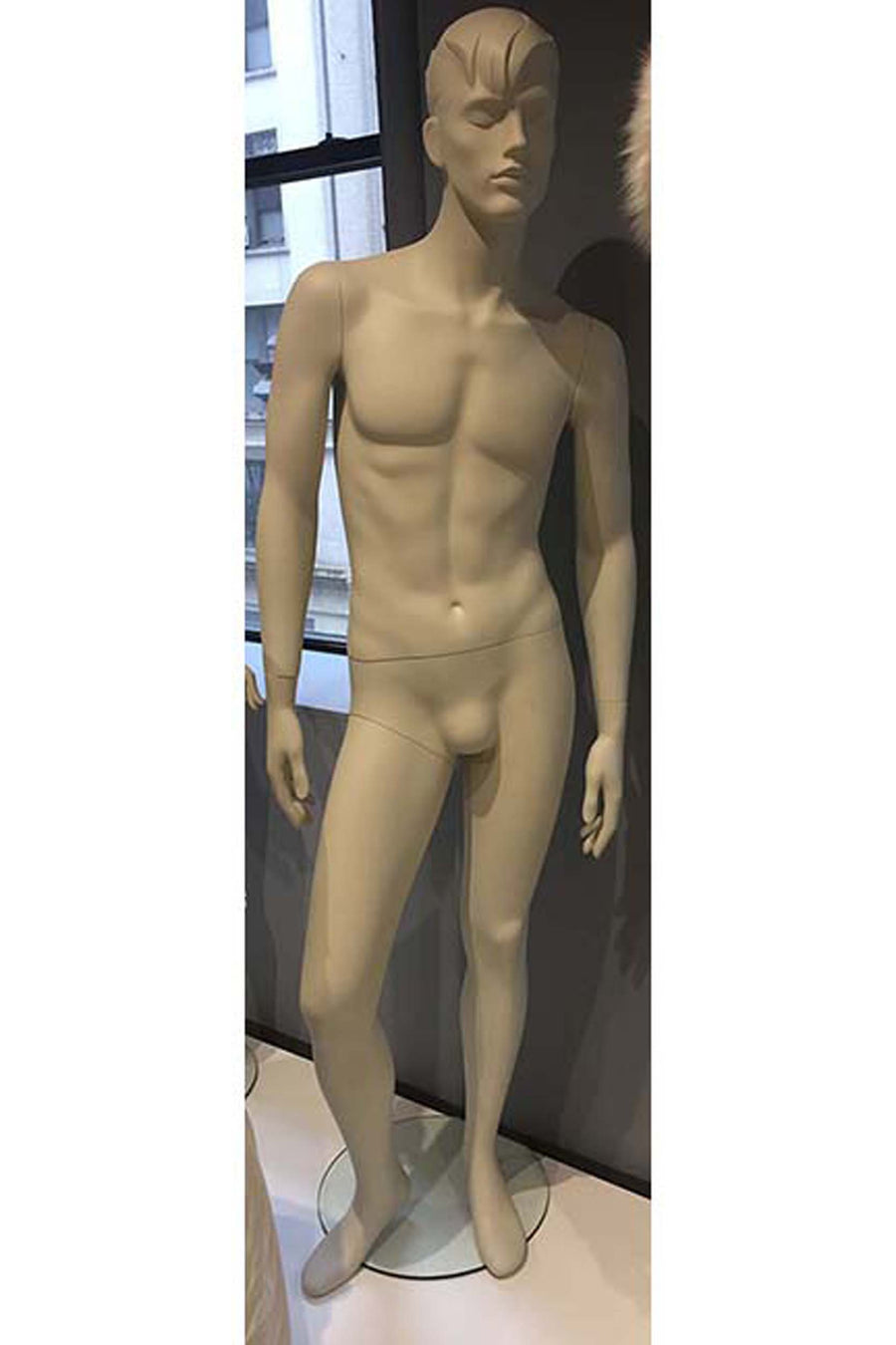 oyster white male mannequin with sculpted hair, arms at sides, and right leg slightly bent