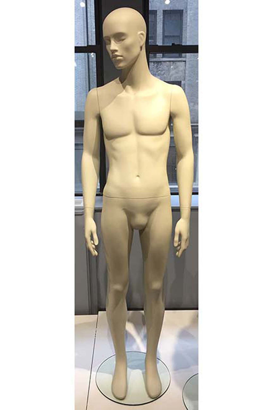 oyster white male mannequin with head turned slightly right and arms and legs relaxed at sides