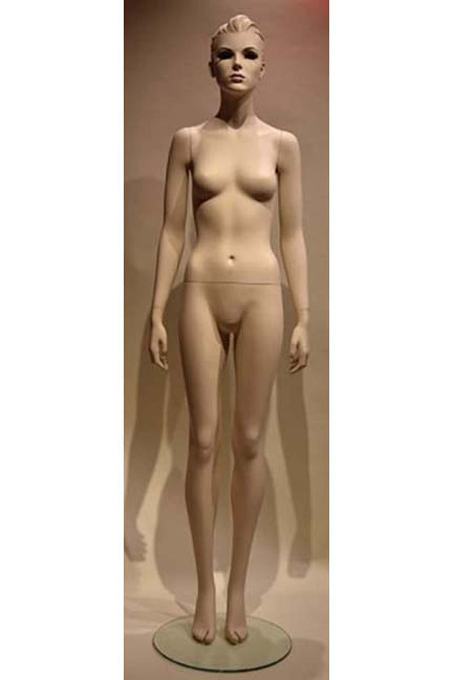 alabaster female mannequin with arms at sides and legs together