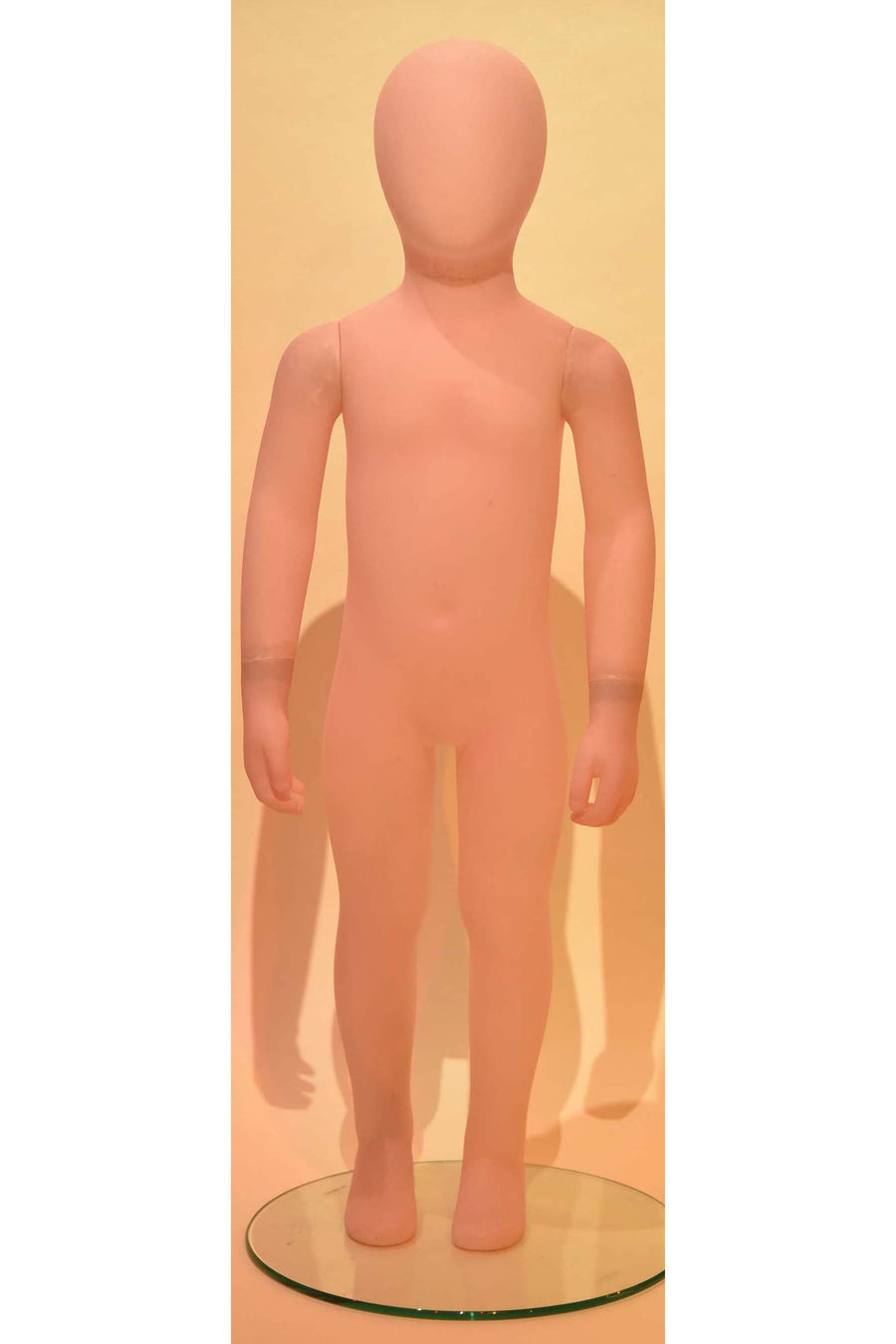 frosted pink kids mannequin with blank face and arms at sides