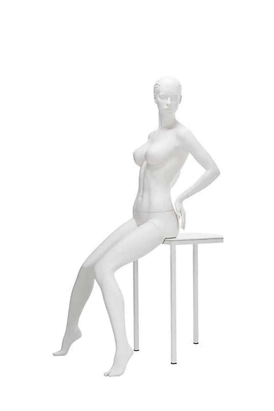 natural pale female seated mannequin with arms on hips