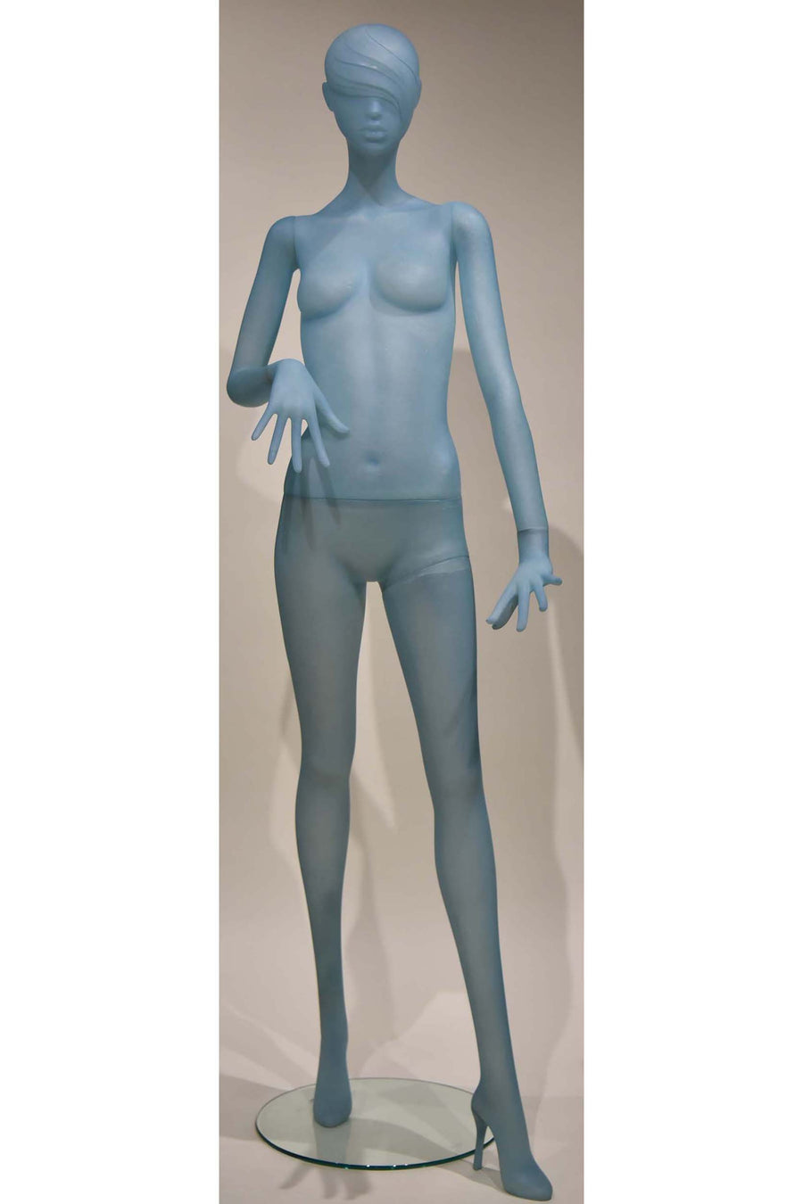 frosted blue female mannequin with left arm straight and right arm bent