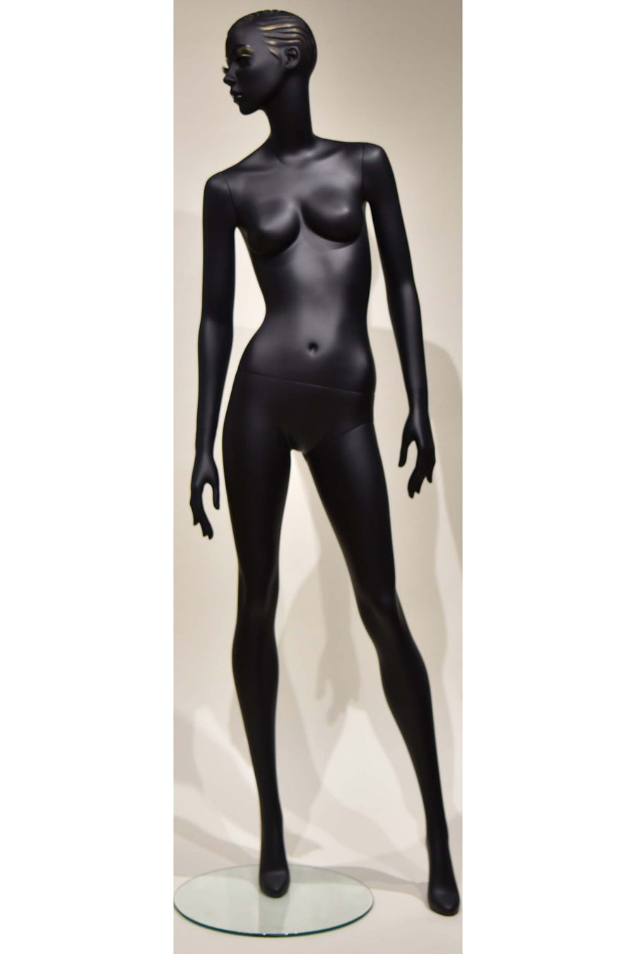 jet black female mannequin with head looking right