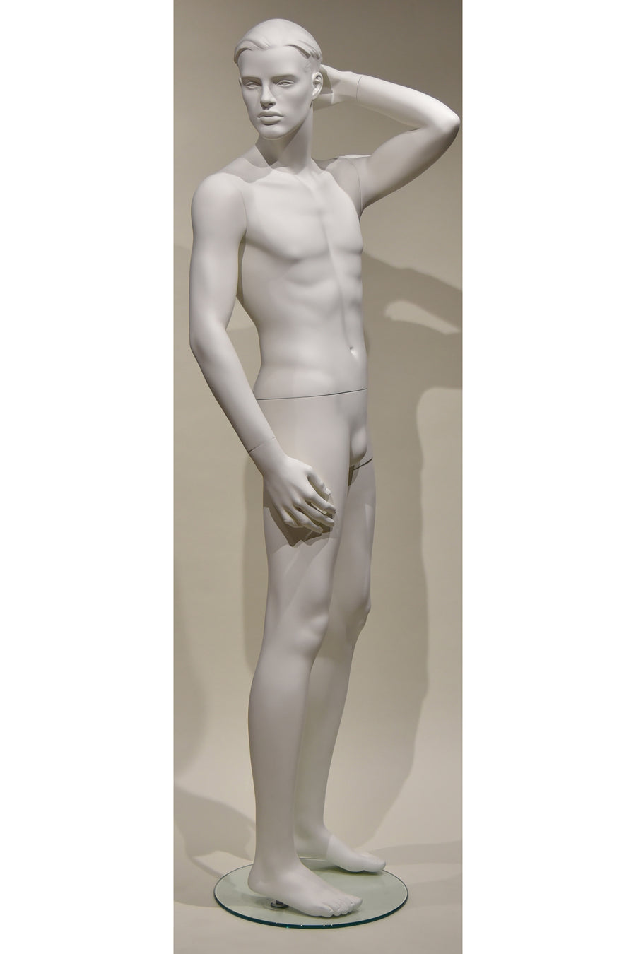pure white male mannequin with left hand on head and head looking right
